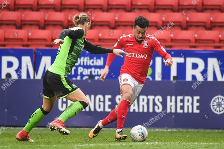 Charlton Athletic Forward Leon Best (8) and Plymouth Argyle Defender Oscar Threlkeld (18) in action during the EFL Sky Bet League 1 match between Charlton Athletic and Plymouth Argyle at The Valley, London. Picture by Stephen Wright