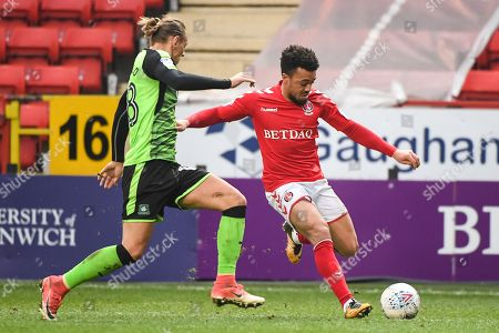 Stock Photo of Charlton Athletic Forward Leon Best (8) and Plymouth Argyle Defender Oscar Threlkeld (18) in action during the EFL Sky Bet League 1 match between Charlton Athletic and Plymouth Argyle at The Valley, London. Picture by Stephen Wright