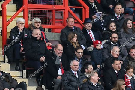 Ex Charlton Manager, Alan Curbishley, watches the match alongside ex Charlton player, Keith Peacock (wearing the hat in the back row) during Charlton Athletic vs Plymouth Argyle, Sky Bet EFL League 1 Football at The Valley on 24th March 2018