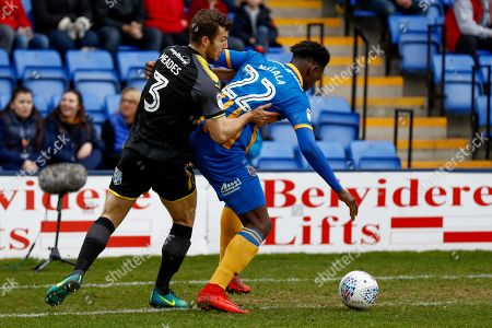 AFC Wimbledon defender Jonathan Meades (3) challenges Shrewsbury Town defender Aristote Nsiala (22)  during the EFL Sky Bet League 1 match between Shrewsbury Town and AFC Wimbledon at Greenhous Meadow, Shrewsbury. Picture by Simon Davies