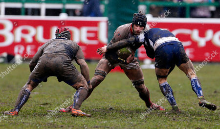 Stock Image of George Mills of Plymouth Albion is tackled by Dave Brazier of Coventry during the National Division 1 match between Plymouth Albion v Coventry at the Brickfields Recreation Ground, on March 24th 2018, Plymouth, Devon, UK.