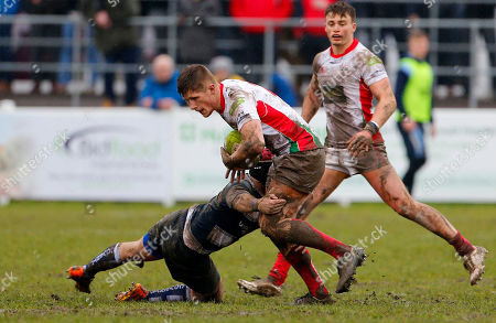 Sam Daly of Plymouth Albion is tackled by Jack Preece of Coventry during the National Division 1 match between Plymouth Albion v Coventry at the Brickfields Recreation Ground, on March 24th 2018, Plymouth, Devon, UK.