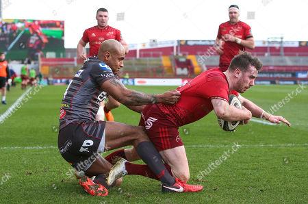 Munster vs Scarlets . Munster's JJ Hanrahan with Tom Varndell of the Scarlets