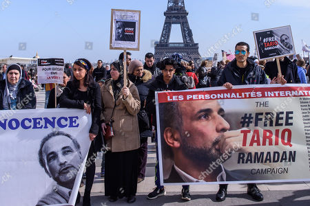 People hold placards which read  'Free Tariq Ramadan' during a gathering in support of Islamic scholar Tariq Ramadan, in Paris, France, 24 March 2018. Tariq Ramadan is detained in France on alleged sexual harassment and rape charges. Ramadan is detained for questioning in Paris, months after women filed rape charges or sexual assault against him in France. Ramadan has denied the allegations.