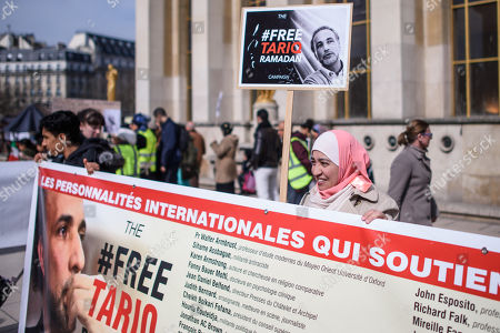 A woman holds a placard which read  'Free Tariq Ramadan' during a gathering in support of Islamic scholar Tariq Ramadan, in Paris, France, 24 March 2018. Tariq Ramadan is detained in France on alleged sexual harassment and rape charges. Ramadan is detained for questioning in Paris, months after women filed rape charges or sexual assault against him in France. Ramadan has denied the allegations.