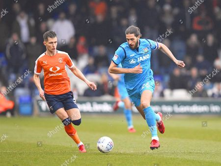 Barnet captain Dan Sweeney moves the ball down the field in the first half during the EFL Sky Bet League 2 match between Luton Town and Barnet at Kenilworth Road, Luton. Picture by Ian  Muir