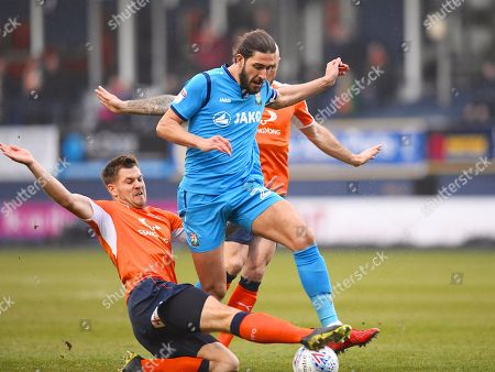 Barnet captain Dan Sweeney is tackled in the first half during the EFL Sky Bet League 2 match between Luton Town and Barnet at Kenilworth Road, Luton. Picture by Ian  Muir