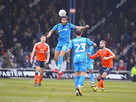 Barnet captain Dan Sweeney wins a high ball in the first half during the EFL Sky Bet League 2 match between Luton Town and Barnet at Kenilworth Road, Luton. Picture by Ian  Muir.during the EFL Sky Bet League 2 match between Luton Town and Barnet at Kenilworth Road, Luton, England on 24 March 2018. Picture by Ian  Muir