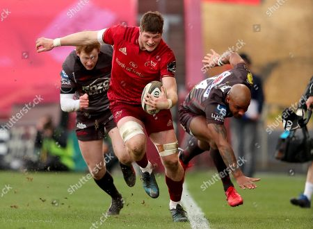 Munster vs Scarlets . Munster's Jack O'Donoghue with Rhys Patchell and Tom Varndell of the Scarlets