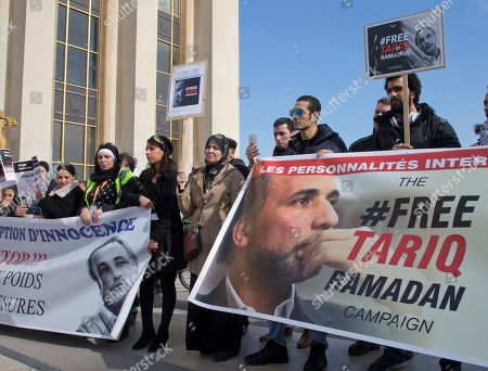 Supporters of Muslim scholar Tariq Ramadan stage a protest in Paris, France, . Prominent Muslim scholar Tariq Ramadan is being held in jail after he was handed preliminary rape charges based on allegations from two women