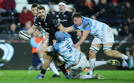 Ashley Beck of Ospreys looks for support as he is tackled by Scott Fardy of Leinster