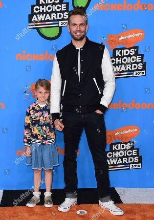 John Brotherton, Saylor Brotherton. John Brotherton, right, and Saylor Brotherton arrive at the Kids' Choice Awards at The Forum, in Inglewood, Calif