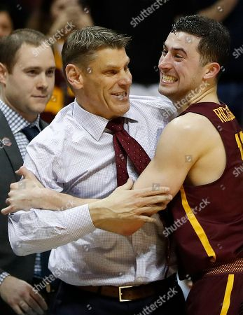 Loyola-Chicago guard Ben Richardson (14) celebrates with Loyola-Chicago head coach Porter Moser during the second half of a regional final NCAA college basketball tournament game against Kansas State, in Atlanta. Loyola-Chicago won 78-62