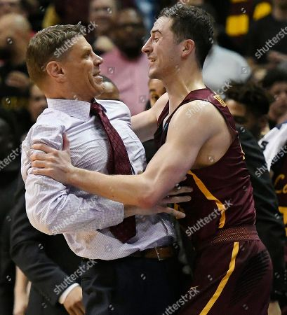 Loyola-Chicago guard Ben Richardson (14) embraces Loyola-Chicago head coach Porter Moser after a regional final NCAA college basketball tournament game against Kansas State, in Atlanta. Loyola-Chicago won 78-62