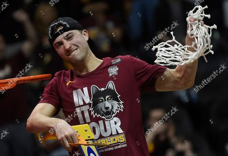 Loyola-Chicago guard Ben Richardson holds the net after a regional final NCAA college basketball tournament game against Kansas State, in Atlanta. Loyola-Chicago won 78-62