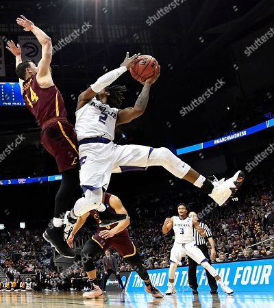 Kansas State guard Cartier Diarra (2) shoots against Loyola-Chicago guard Ben Richardson (14) during the second half of a regional final NCAA college basketball tournament game, in Atlanta. Loyola-Chicago won 78-62