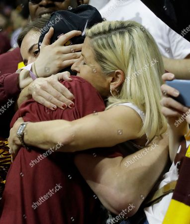 Loyola-Chicago guard Ben Richardson embraces his mother Anna Richardson after a regional final NCAA college basketball tournament game against Kansas State, in Atlanta. Loyola-Chicago won 78-62