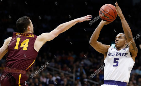 Kansas State guard Barry Brown (5) shoots against Loyola-Chicago guard Ben Richardson (14) during the first half of a regional final NCAA college basketball tournament game, in Atlanta