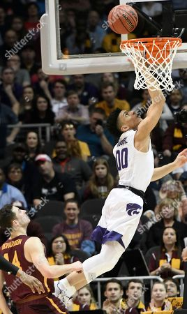 Kansas State guard Mike McGuirl (00) shoots against Loyola-Chicago guard Ben Richardson (14) during the first half of a regional final NCAA college basketball tournament game, in Atlanta