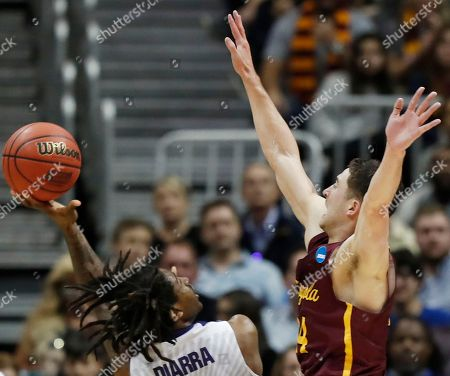 Kansas State guard Cartier Diarra (2) shoots against Loyola-Chicago guard Ben Richardson (14) during the second half of a regional final NCAA college basketball tournament game, in Atlanta