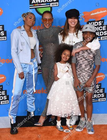 Stock Image of Mel B, Phoenix Chi Gulzar, Madison Brown Belafonte, Giselle Belafonte, Angel Murphy Brown. Mel B, wearing glasses, and from left, Phoenix Chi Gulzar, Madison Brown Belafonte, Giselle Belafonte, and Angel Murphy Brown arrive at the Kids' Choice Awards at The Forum, in Inglewood, Calif