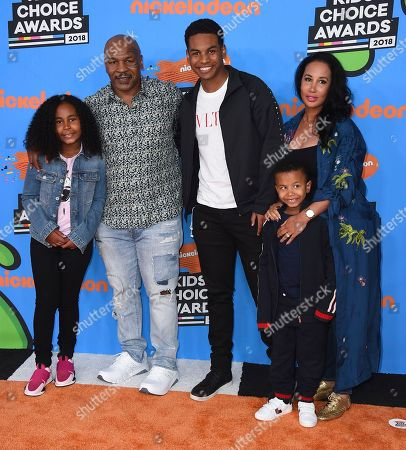 Mike Tyson, Lakiha Spicer, Milan Tyson, Miguel Leon Tyson, Morocco Tyson. Mike Tyson, second left, and Lakiha Spicer, right, and from left, Milan Tyson, Miguel Leon Tyson, and Morocco Tyson arrive at the Kids' Choice Awards at The Forum, in Inglewood, Calif