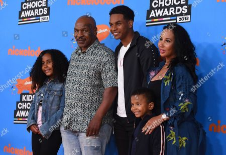 Stock Image of Mike Tyson, Lakiha Spicer, Milan Tyson, Miguel Leon Tyson, Morocco Tyson. Mike Tyson, second left, and Lakiha Spicer, right, and from left, Milan Tyson, Miguel Leon Tyson, and Morocco Tyson arrive at the Kids' Choice Awards at The Forum, in Inglewood, Calif