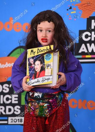 Stock Photo of Parker Ballinger, dressed as Miranda Sings, arrives at the Kids' Choice Awards at The Forum, in Inglewood, Calif