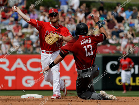 Stock Photo of Los Angeles Angels shortstop Nolan Fontana throws to first after forcing out Arizona Diamondbacks' Adam Walton during the third inning of a spring training baseball game in Tempe, Ariz., . Jake Lamb was safe at first