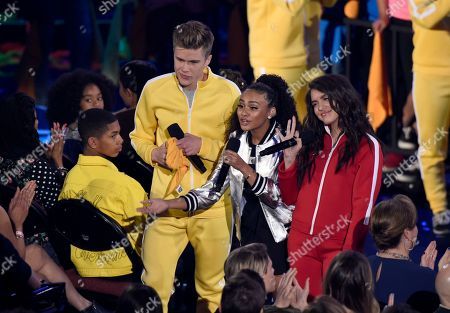 Daniella Perkins, Owen Joyner, Lilimar Hernandez. Owen Joyner, from left, Daniella Perkins, and Lilimar Hernandez present the award for favorite TV actor at the Kids' Choice Awards at The Forum, in Inglewood, Calif