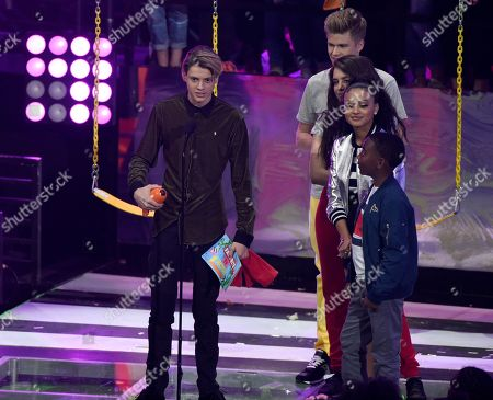 "Jace Norman, Owen Joyner, Lilimar Hernandez, Daniella Perkins. Jace Norman, left, accepts the award for favorite TV actor for ""Henry Danger"" at the Kids' Choice Awards at The Forum, in Inglewood, Calif. Looking on from right are Daniella Perkins, Lilimar Hernandez, and Owen Joyner"