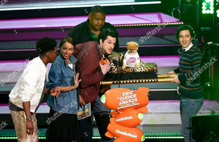 Brandon Mychal Smith, Kat Graham, Omar Benson Miller, Ben Schwartz, Josh Brener, Jiffpom. Jiffpom, winner of the award for favorite Instagram pet, appears onstage with presenters from left, Brandon Mychal Smith, Kat Graham, Ben Schwartz, Omar Benson Miller, and Josh Brener at the Kids' Choice Awards at The Forum, in Inglewood, Calif