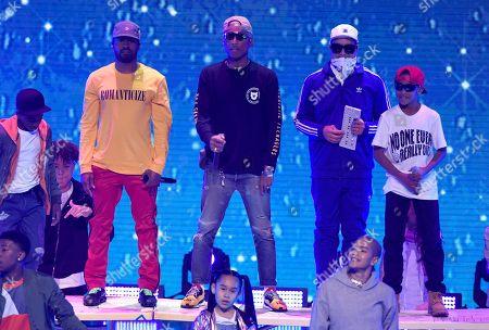 "Shay Haley, Pharrell Williams, Chad Hugo. Shay Haley, from left, Pharrell Williams, and Chad Hugo of N.E.R.D perform ""Lemon"" at the Kids' Choice Awards at The Forum, in Inglewood, Calif"