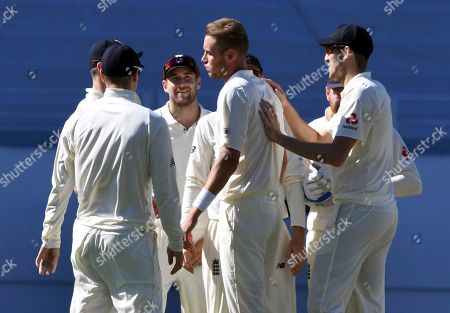 Stock Photo of Chris Broad. England's Stuart Broad, center, reacts after dismissing New Zealand's Todd Astle for 18 during the first cricket test in Auckland, New Zealand