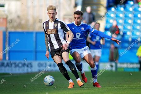 Chesterfield forward Jacob Brown (44)  and Notts County defender Daniel Jones (23) during the EFL Sky Bet League 2 match between Chesterfield and Notts County at the Proact stadium, Chesterfield. Picture by Nigel Cole