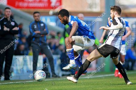 Chesterfield midfielder Zavon Hines (41) and Notts County midfielder Jorge Grant (10)  during the EFL Sky Bet League 2 match between Chesterfield and Notts County at the Proact stadium, Chesterfield. Picture by Nigel Cole