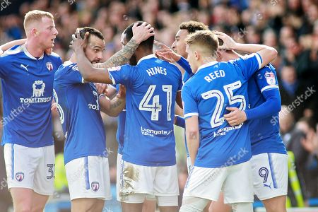 Chesterfield midfielder Zavon Hines (41) celebrates his goal with teammates during the EFL Sky Bet League 2 match between Chesterfield and Notts County at the Proact stadium, Chesterfield. Picture by Nigel Cole