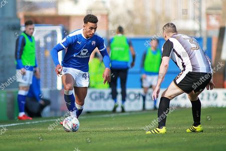 Chesterfield forward Jacob Brown (44) takes on Notts County defender Carl Dickinson (3)    during the EFL Sky Bet League 2 match between Chesterfield and Notts County at the Proact stadium, Chesterfield. Picture by Nigel Cole