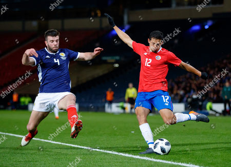 Grant Hanley of Scotland tries to block a cross from Daniel Colindres of Costa Rica