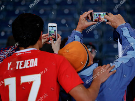Yeltsin Tejeda of Costa Rica poses for mobile phone pictures with Costa Rica fans