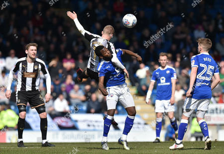 Terry Hawkridge of Notts County and Zavon Hines of Chesterfield compete
