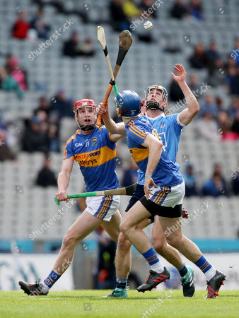 Stock Image of Dublin vs Tipperary . Dublin's Rian McBride and Billy McCarthy with John McGrath of Tipperary