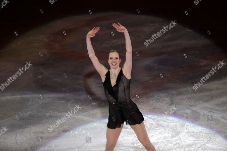Carolina Kostner of Italy waves to spectators after performing during the gala exhibition, at the Figure Skating World Championships in Assago, near Milan, Italy