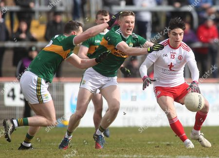 Tyrone vs Kerry. Tyrone's Lee Brennan with Kerry's Mark Griffin and Jason Foley