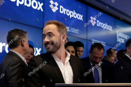 Dropbox co-founder Drew Houston, left, at the Nasdaq MarketSite during the company's IPO, in New York's Times Square
