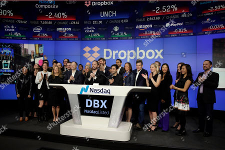 Drew Houston, Arash Ferdowsi. Dropbox co-founders Drew Houston, center left, Arash Ferdowsi, center right, and company executives celebrate as they ring the opening bell iat the NasdaqMarketSite, in New York's Times Square, to celebrate the company's IPO