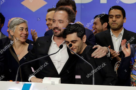 Drew Houston, Arash Ferdowsi. Dropbox co-founders Drew Houston, center left, Arash Ferdowsi, center right, and company executives celebrate as they ring the opening bell at the NasdaqMarketSite, in New York's Times Square, to celebrate the company's IPO