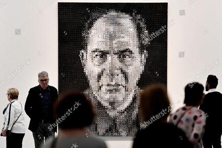 Visitors look at an artwork entitled 'Joel' by US artist Chuck Close, on display in the exhibition 'Black and White. From Duerer to Eliasson' at the Museum Kunstpalast in Duesseldorf, Germany, 25 March 2018. The exibition exploring black-and-white art runs from 22 March to 15 July.