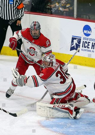 Sean Romeo, Matt Miller. Ohio State goalie Sean Romeo (30) catches the puck in front of teammate Matt Miller (50) against Denver during the third period of the NCAA college hockey Midwest Regional Final game, in Allentown, Pa. Ohio State defeated Denver 5-1