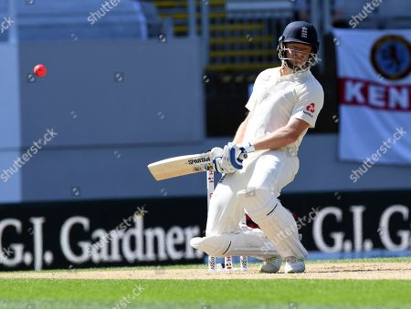 England's Jonathan Bairstow ducks a bouncer from New Zealand's Neil Wagner during their first cricket test in Auckland, New Zealand